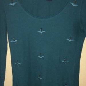 Green thermal top with embroidery and beads